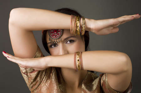 Beautiful brunette portrait with traditionl costume.  Indian style    Stock Photo - 9372871