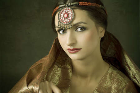 Beautiful brunette portrait with traditional costume. Indian style  photo