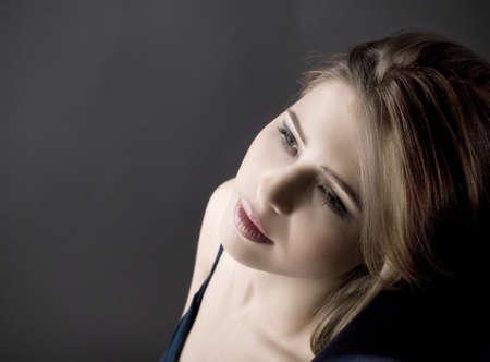 Portrait of a young sad beautiful woman  photo