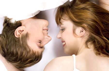 touched: Young cheerful couple touched one anothers nose  Stock Photo