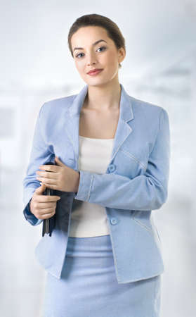 Portrait of a young attractive business woman. Stock Photo - 9503754