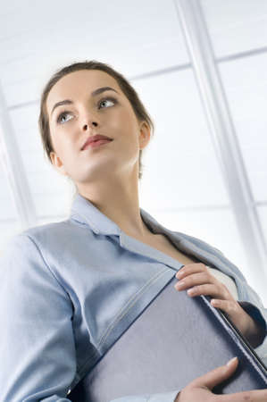 beautiful smiley business woman  holding folder with papers Stock Photo - 9503787