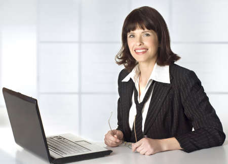 Beautiful brunette businesswoman with laptop computer Stock Photo - 9503746