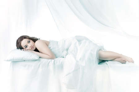 one sheet: Beautiful woman sleeping over a white background
