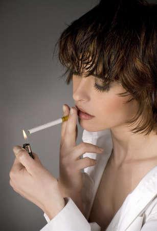 cigarette lighter: Beautiful woman smoking a cigarette