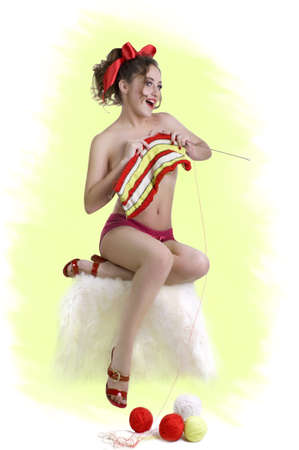 Merry girl with knitting Stock Photo - 9609517