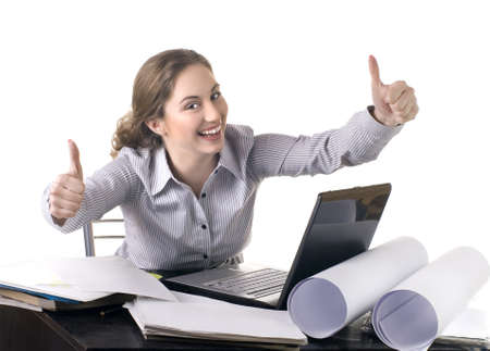 young business woman at office with laptop giving thumbs-up-sign  photo