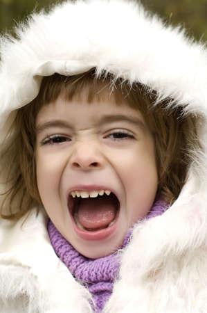 Portrait of a loudly  child photo