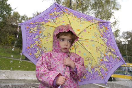 girl with an umbrella in the rain photo
