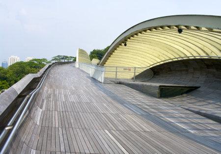 Modern pedestrian bridge connecting parks