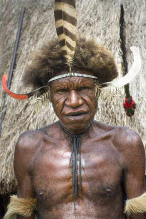 28: NEW GUINEA, INDONESIA -DECEMBER 28: The warrior of a Papuan tribe in traditional clothes and coloring in New Guinea Island, Indonesia on December 28, 2010  Editorial