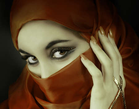 Portrait of a young  beautiful muslim woman photo