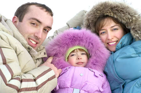 happy young parents with daughter on to snow photo