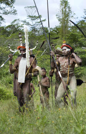 NEW GUINEA, INDONESIA -DECEMBER 28: Unidentified warriors of a Papuan tribe in traditional clothes and coloring in New Guinea Island, Indonesia on December 28, 2010