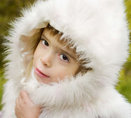 Adorable  child in winter style photo