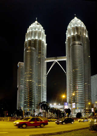 KUALA LUMPUR, MALAYSIA - AUGUST 20: Night view of The Petronas Twin Towers on August 20, 2011 in Kuala Lumpur, Malaysia. The skyscraper is the tallest twin buildings in the world (451.9m/88 floors).   Stock Photo - 11729322