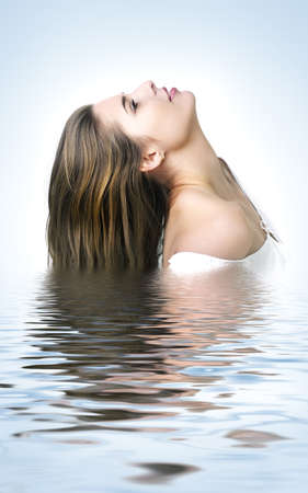 remedial: Profile  portrait of the beautiful young woman with long  hairs, reflected in waters