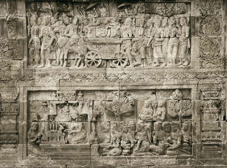 Detail of carved relief at Borobudur on Java, Indonesia.  photo