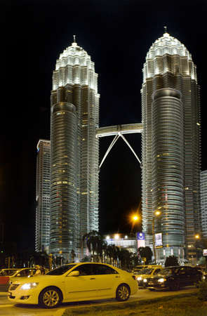KUALA LUMPUR, MALAYSIA - AUGUST 20: Night view of The Petronas Twin Towers on August 20, 2011 in Kuala Lumpur, Malaysia. The skyscraper is the tallest twin buildings in the world (451.9m/88 floors).  Stock Photo - 12355136