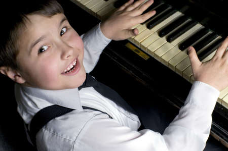 Little boy and piano.  photo