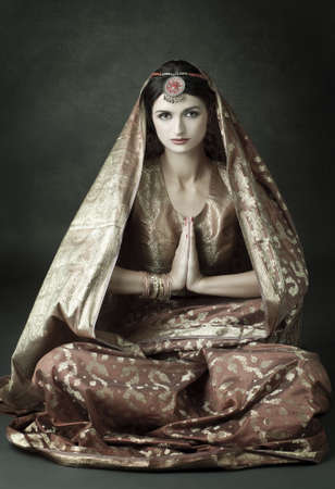 Beautiful indian brunette in traditional costume  photo
