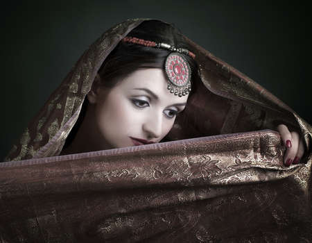asian bride: Beautiful brunette portrait with traditional  indian costume.