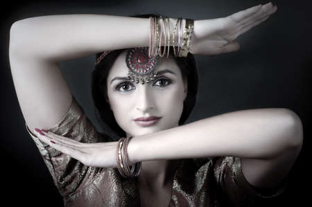 Beautiful brunette portrait with traditional indian costume photo