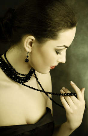 sholders: picture of beautiful woman with beads  Stock Photo