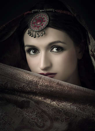 arab girl: Beautiful brunette portrait with traditional indian costume Stock Photo