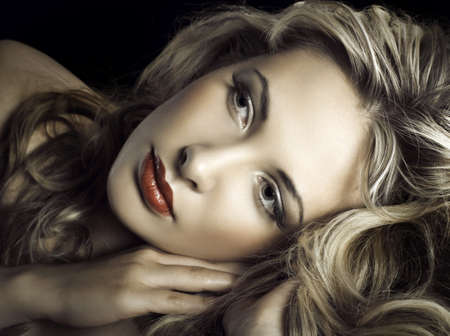 Gorgeous portrait of a young beautiful blonde woman  Stock Photo - 12666646