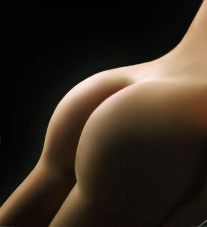Beautiful ass of young woman over dark background  Stock Photo - 12724526