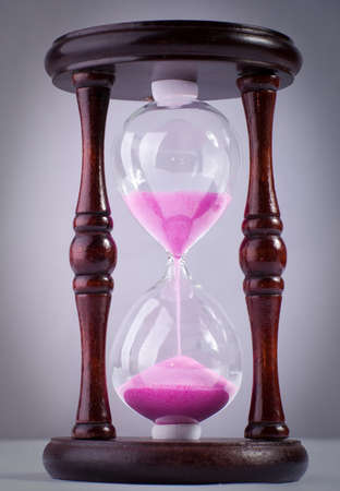 The old hourglass with pink sand photo