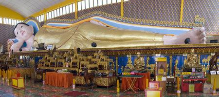 Sculpture Sleeping buddha at the Thai temple Wat Chayamangkalaram on island Penang, Malaysia