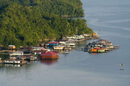 lake dwelling: Houses on an island on the lake Sentani, New Guinea Stock Photo