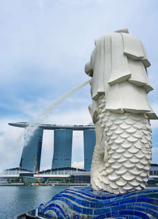 SINGAPORE-AUG 21 The Merlion fountain and Marina Bay Sands Resort Aug 21, 2011 in Singapore Merlion is a mythical creature with the head of a lion and the body of a fish,and is a symbol of Singapore