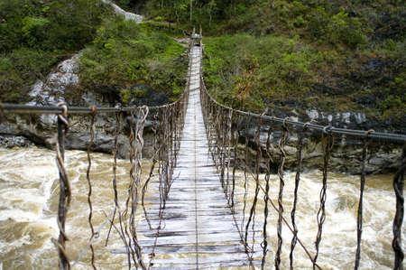 ニューギニアのロープの橋 写真素材