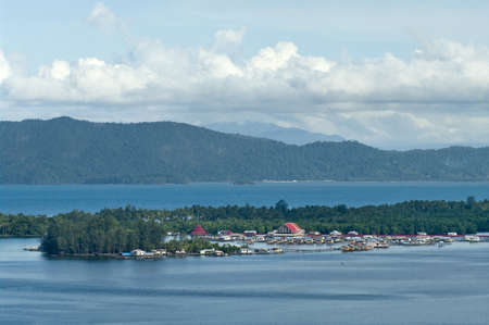 pile dwelling: Houses on an island on the lake Sentani, New Guinea Stock Photo