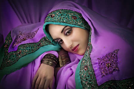 indian bride: Portrait of young beautiful  woman in traditional indian costume