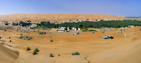 Panorama of the village in the Wahiba Sands, Oman photo