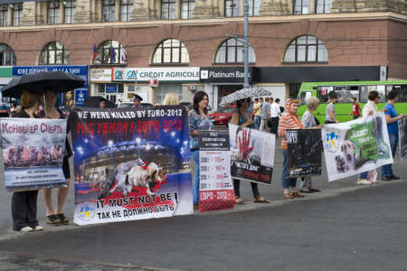 KHARKIV, UKRAINE MAY 16:Organised rally protect of animals while Public demonstration of the cup UEFA on the Freedom Square  in Kharkiv, Ukraine on May 16, 2012.