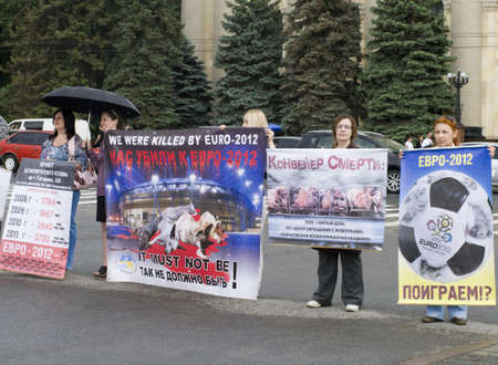 KHARKIV, UKRAINE MAY 16 Organized rally protect of animals in connection with murder homeless animals to  EURO Championship while public demonstration of cup UEFA in Kharkiv, Ukraine on May16, 2012  Stock Photo - 13651886