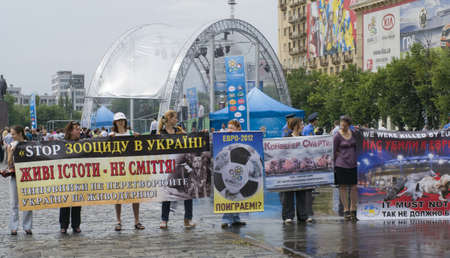 KHARKIV, UKRAINE MAY 16 Organised rally protect of animals while Public demonstration of the cup UEFA on the Freedom Square  in Kharkiv, Ukraine on May 16, 2012    Stock Photo - 13651674