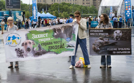 KHARKIV, UKRAINE MAY 16 Organised rally protect of animals while Public demonstration of the cup UEFA on the Freedom Square  in Kharkiv, Ukraine on May 16, 2012    Stock Photo - 13651671