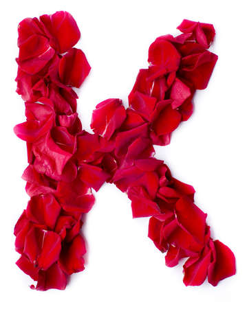 alphabet K made from red petals rose photo
