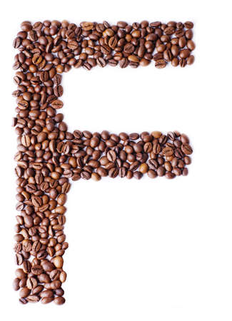 Alphabet from coffee beans  Isolated on white background   photo