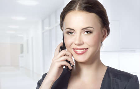 portrait of business woman talking on the phone isolated on white photo