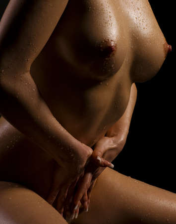 Beautiful wet female body on dark background
