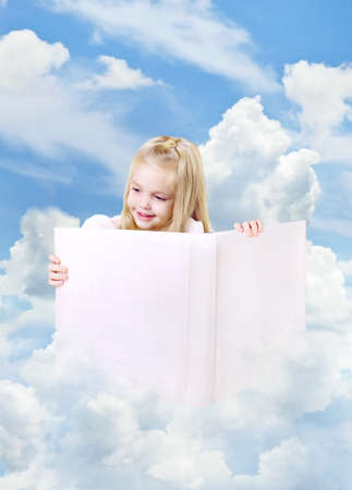 homestudy: Portrait of a little girl with book on the clouds