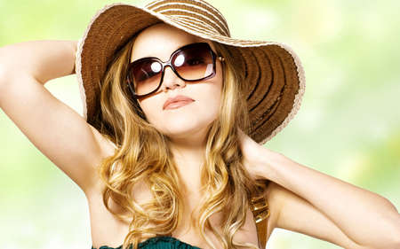 Portrait of beautiful model in  hat with glasses  photo