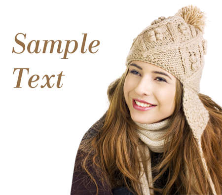 Pretty teen in winter outfits on a white background Sample text space to the left  photo